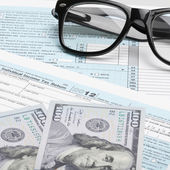US Tax Form 1040 with glasses and 100 US dollars — Stock Photo
