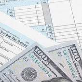 Tax Form 1040 with two 100 dollars banknotes — Stock Photo