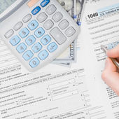 Filling out 1040 US Tax Form - view from top — Stock Photo
