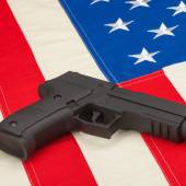 Handgun and USA flag — Stock Photo