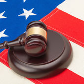 Wooden gavel and soundboard over USA flag — Stock Photo