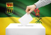 Voting concept - Ballot box with national flag on background - Saskatchewan — Stock Photo