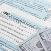 USA Tax 1040 Form 1040 and 100 US dollar bills — Stock Photo