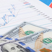 Stock market graph with 100 dollars banknote - market concept — Stockfoto