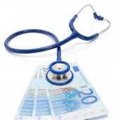 EURO currency with stethoscope over it - healthcare concept — Foto de Stock