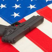 Handgun laying over USA flag - self-defense law concept — Stock Photo
