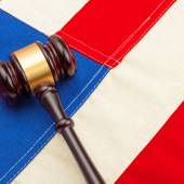 Wooden judge gavel over US flag - court judgment concept — Stock Photo