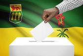 Voting concept - Ballot box with Canadian province flag on background - Saskatchewan — Stock Photo