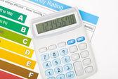 Calculator over energy efficiency chart — Stock Photo
