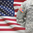 American soldier with flag on background - United States — Stock Photo #63524497
