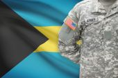 American soldier with flag on background - Bahamas — Stock Photo