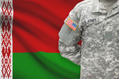 American soldier with flag on background - Belarus — Stock Photo