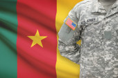 American soldier with flag on background - Cameroon — Stock Photo