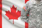 American soldier with flag on background - Canada — Stock Photo