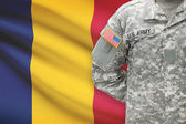 American soldier with flag on background - Chad — Stock Photo