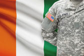 American soldier with flag on background - Cote d'Ivoire - Ivory Coast — Stock Photo