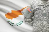 American soldier with flag on background - Cyprus — Stock Photo