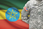 American soldier with flag on background - Ethiopia — Stock Photo
