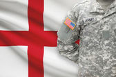 American soldier with flag on background - England — Stock Photo
