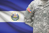 American soldier with flag on background - El Salvador — Stock Photo