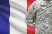 American soldier with flag on background - France — Stock Photo