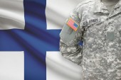 American soldier with flag on background - Finland — Stock Photo