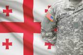 American soldier with flag on background - Georgia — Stock Photo