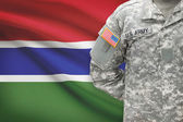 American soldier with flag on background - Gambia — Stock Photo