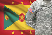 American soldier with flag on background - Grenada — Stock Photo