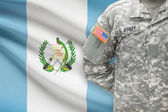 American soldier with flag on background - Guatemala — Stock Photo