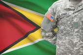 American soldier with flag on background - Guyana — Stock Photo