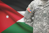 American soldier with flag on background - Jordan — Stock Photo