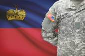 American soldier with flag on background - Principality of Liechtenstein — Stock Photo