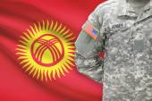 American soldier with flag on background - Kyrgyzstan — Stock Photo