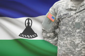 American soldier with flag on background - Lesotho — Stock Photo