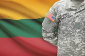 American soldier with flag on background - Lithuania — Stock Photo