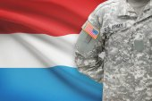 American soldier with flag on background - Luxembourg — Stock Photo