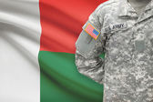 American soldier with flag on background - Madagascar — Stock Photo