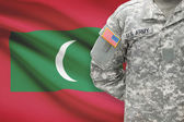 American soldier with flag on background - Maldives — Stock Photo
