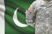 American soldier with flag on background - Pakistan — Stock Photo