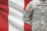 American soldier with flag on background - Peru — Stock Photo