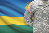 American soldier with flag on background - Rwanda — Stock Photo