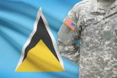 American soldier with flag on background - Saint Lucia — Stock Photo