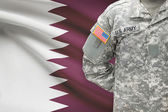 American soldier with flag on background - Qatar — Stock Photo
