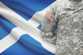 American soldier with flag on background - Scotland — Stock Photo