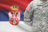 American soldier with flag on background - Serbia — Stock Photo