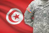American soldier with flag on background - Tunisia — Stock Photo