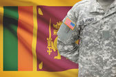 American soldier with flag on background - Sri Lanka — Stock Photo