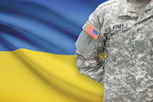 American soldier with flag on background - Ukraine — Stock Photo