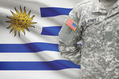 American soldier with flag on background - Uruguay — Stock Photo